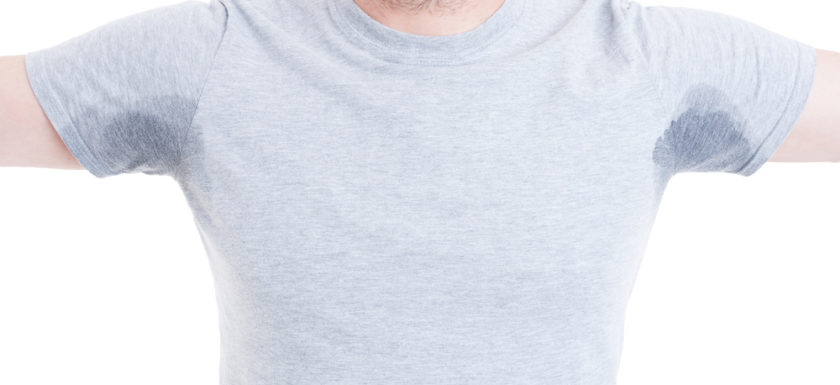 man sweating excessively through tshirt