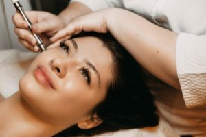 dermapen treatment on smiling woman
