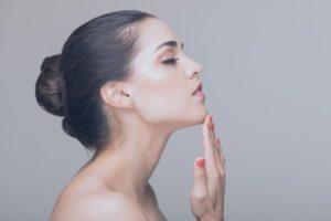 woman touching her chin side profile