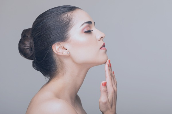 woman touching her chin side profile